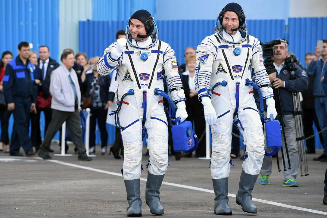 Russian cosmonaut Alexey Ovchinin, left and NASA astronaut Nick Hague walk to the van that carried them to their rocket at the Baikonur cosmodrome in Kazakhstan on October 11, 2018.