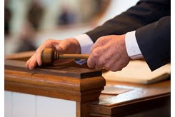 An auctioneer strikes the gavel at Tattersalls in Newmarket