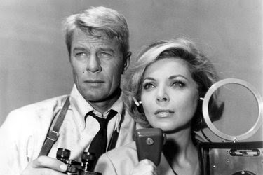"""Peter Graves (as Jim Phelps) and Barbara Bain (as Cinnamon Carter) in the """"Mission Impossible"""" television show."""