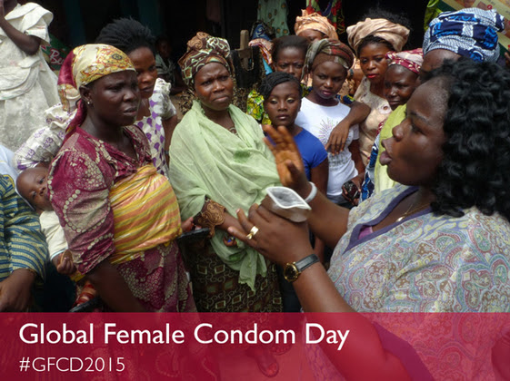 Woman demonstrating use of female condom