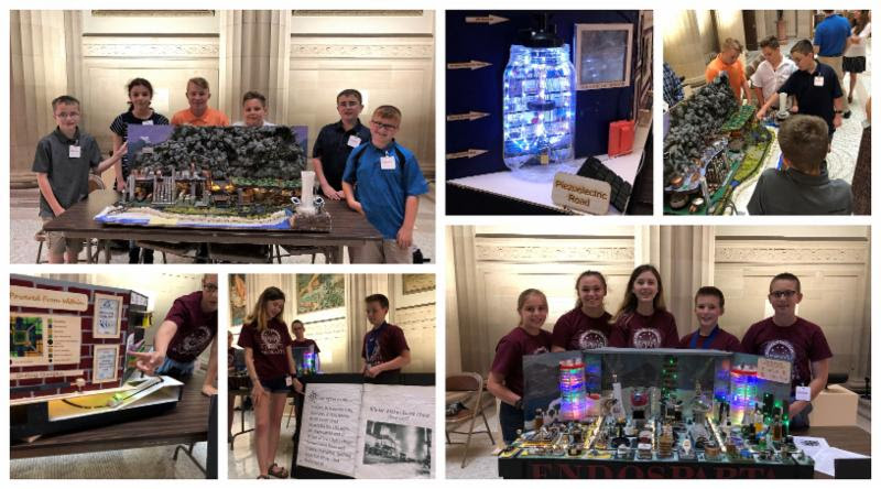 Future City student participants present their projects to NYSED staff