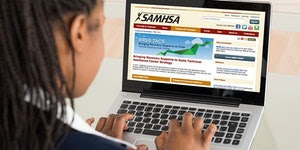 person on a laptop_ screen displaing SAMHSA website
