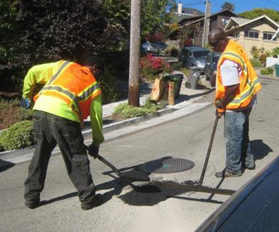 pothole-filled-shovels.jpg