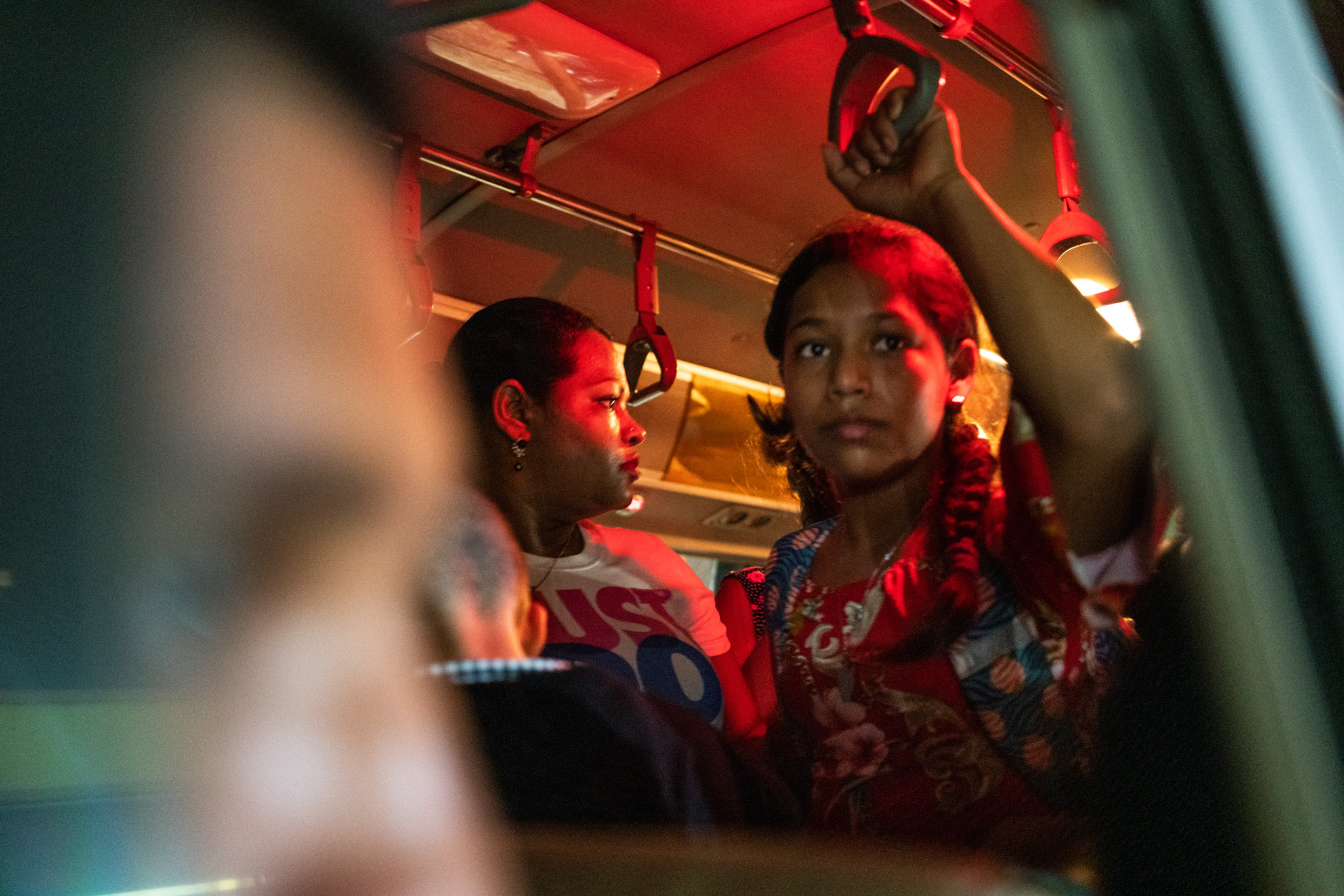 Buses ferry workers to and from their jobs at a clothing factory in Choloma, Honduras, one of the most dangerous cities for women in the world.