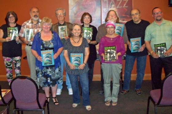 Several Canadian contributors to LUMMOX gathered in Sarnia last month. They included (back row, left to right) Rhonda Melanson, Joe Farnia, David Haskins, Debbie Okun Hill, James Deahl, Michael Mirolla and Denis Robillard (front row, left to right) Jennifer L. Foster, Lynn Tait and Venera Fazio