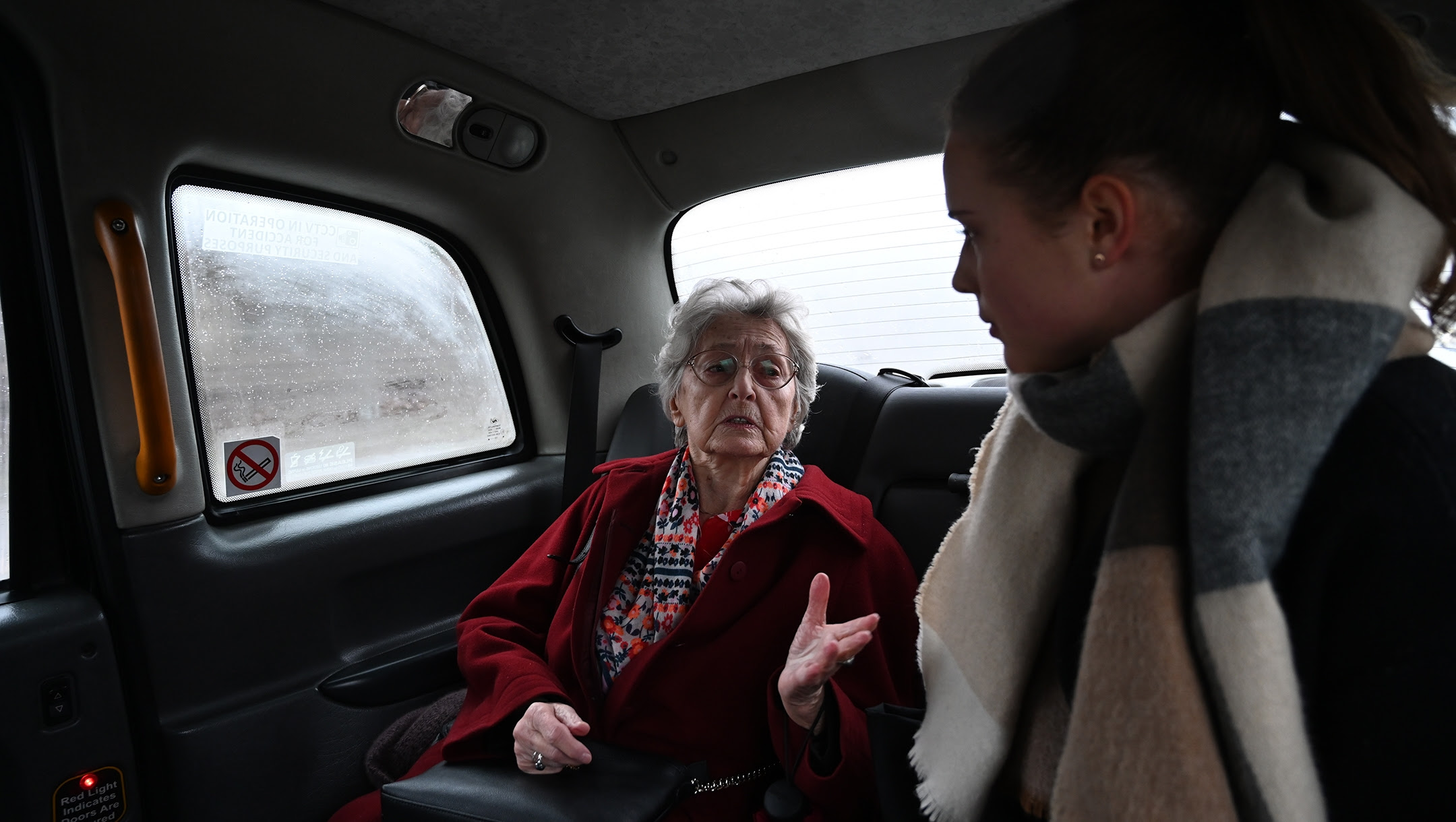 Anna Stupnicka-Bando, the 90-year-old president of the Polish Association of the Righteous Among the Nations, inside one of the From the Depths taxis for saviors of Jews in Warsaw, Poland on Jan. 29, 2020. (Cnaan Liphshiz)