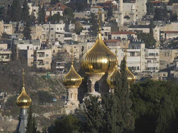 The                                                           Russian                                                           Orthodox                                                           Church of Mary                                                           Magdalene sits                                                           at the base of                                                           the Mount of                                                           Olives near                                                           Gethsemane in                                                           Jerusalem, and                                                             is famous for                                                           its sparkling                                                           golden onion                                                           domes.