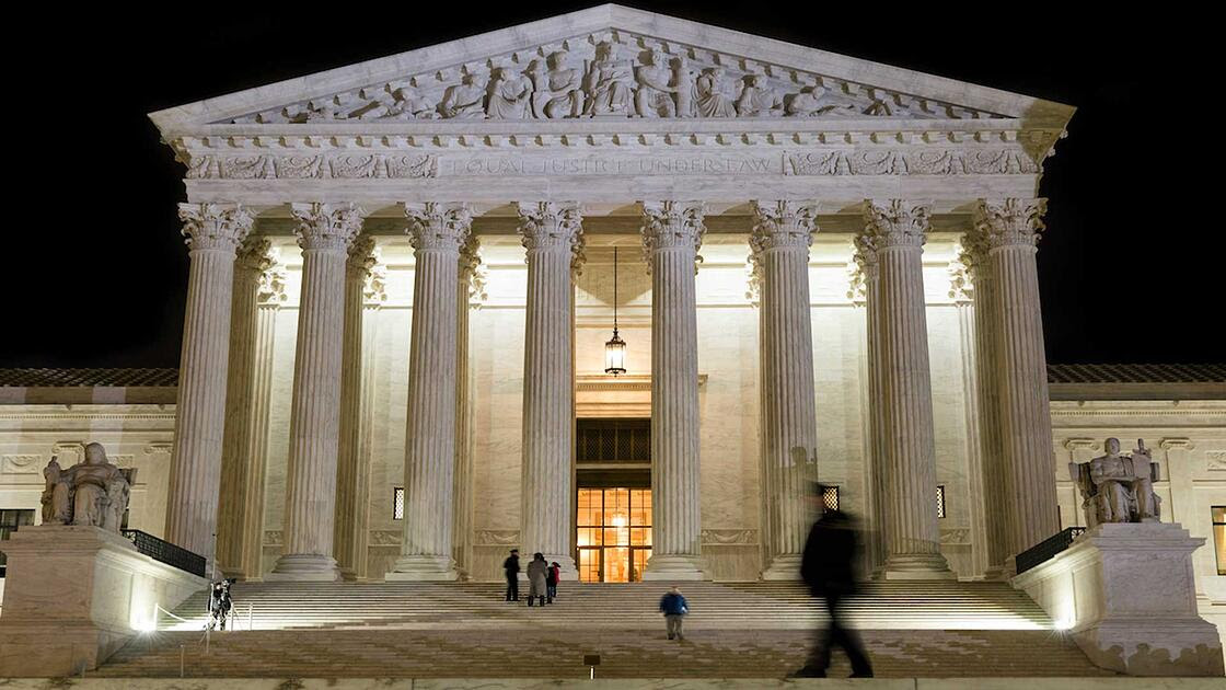 The US Supreme Court building at night
