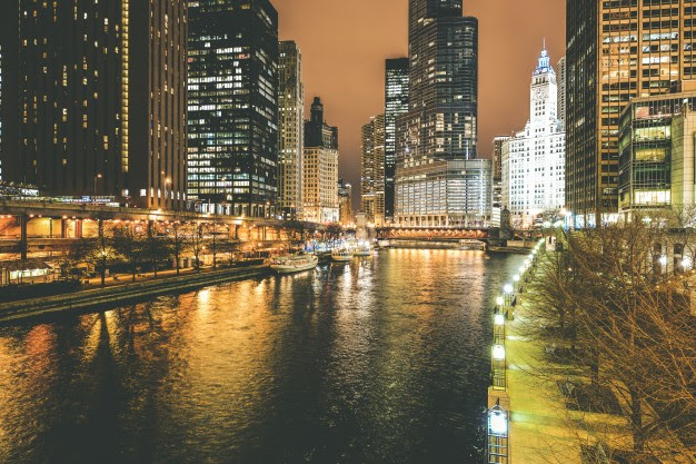 Chicago skyline at night - a destination within reach with our United jet service.