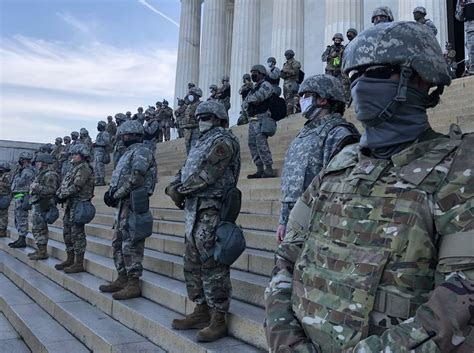 THEATER OF THE ABSURD: Most Popular President In U.S. History To Be Inaugurated In Secret Behind Giant Wall Guarded By Thousands Of Soldiers ?u=https%3A%2F%2Ftse2.mm.bing.net%2Fth%3Fid%3DOIP