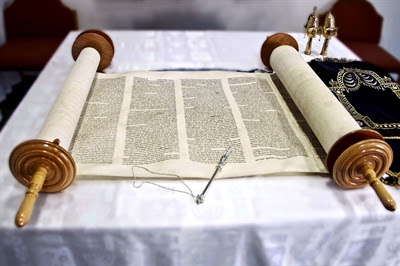 Open                 Torah scroll and silver yad (Torah pointer)