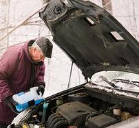 Man putting antifreeze in his car