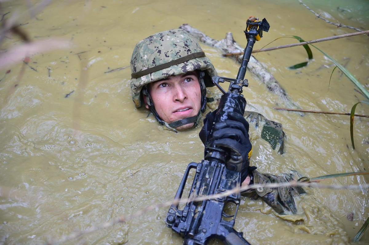 Sometimes working with allies means getting down and dirty. Here a Seabee gets neck deep in Japan.