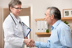 The figure above is a photograph of a health care provider meeting with a patient.