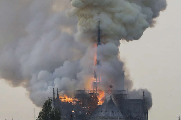 Slide 29 of 31: Flames and smoke are seen billowing from the roof at Notre-Dame Cathedral in Paris on April 15, 2019. - A fire broke out at the landmark Notre-Dame Cathedral in central Paris, potentially involving renovation works being carried out at the site, the fire service said. (Photo by FRANCOIS GUILLOT / AFP)        (Photo credit should read FRANCOIS GUILLOT/AFP/Getty Images)