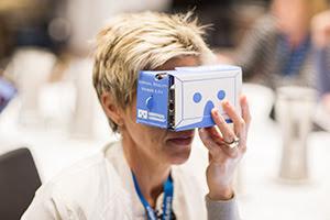 A lady using a virtual reality headset