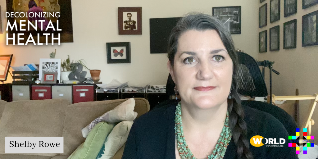 Suicide Prevention Advocate Shelby Rowe looks straight into the camera with authority. She is sitting in her office. Her long dark hair is greying and worn in a braid on the side of her head. Click here for her interview.