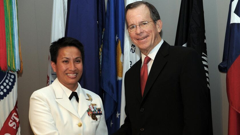 Kimberly Mitchell and her former boss at the Joint Chiefs of Staff, Adm. Mike Mullen, now retired.