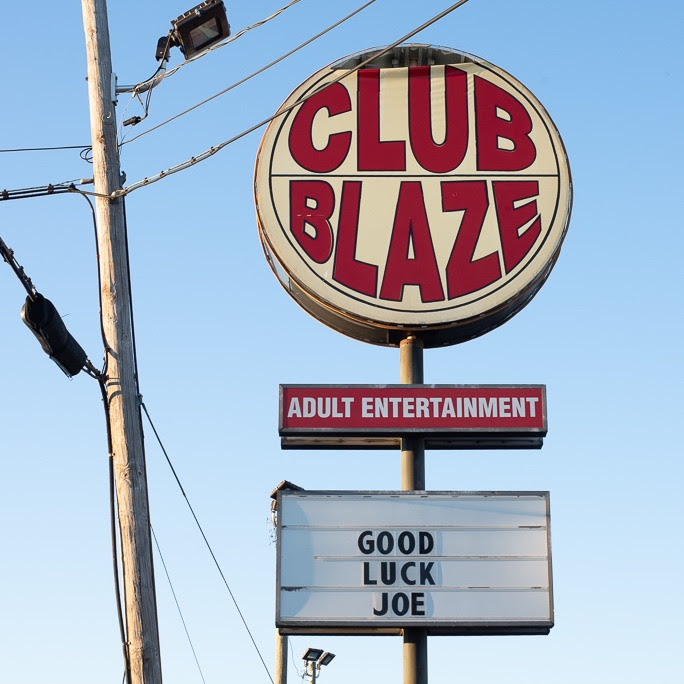 a marquee sign that says CLUB BLAZE and GOOD LUCK JOE