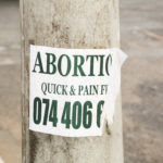 Abortion_Quick_&_Pain_Free_sign,_Joe_Slovo_Park,_Cape_Town,_South_Africa-3869