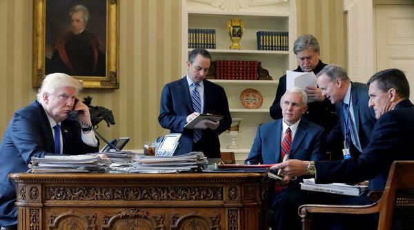 White House senior adviser Steve Bannon, standing at right, in the Oval Office while President Trump speaks with Russian President Vladimir Putin on Jan. 28. (Jonathan Ernst/Reuters)</p>