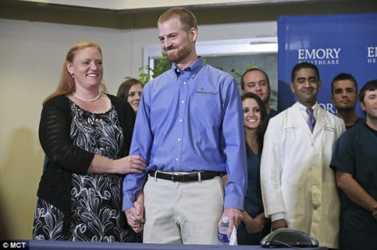 1408657399124_wps_2_Dr_Kent_Brantly_stands_wi