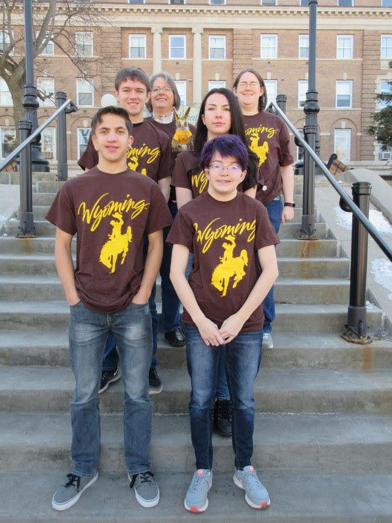 The four Wyoming students that make up the Academic Bowl team stand with their coaches on the steps outside the Iowa School for the Deaf.