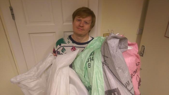Tired John holding full shipping bags