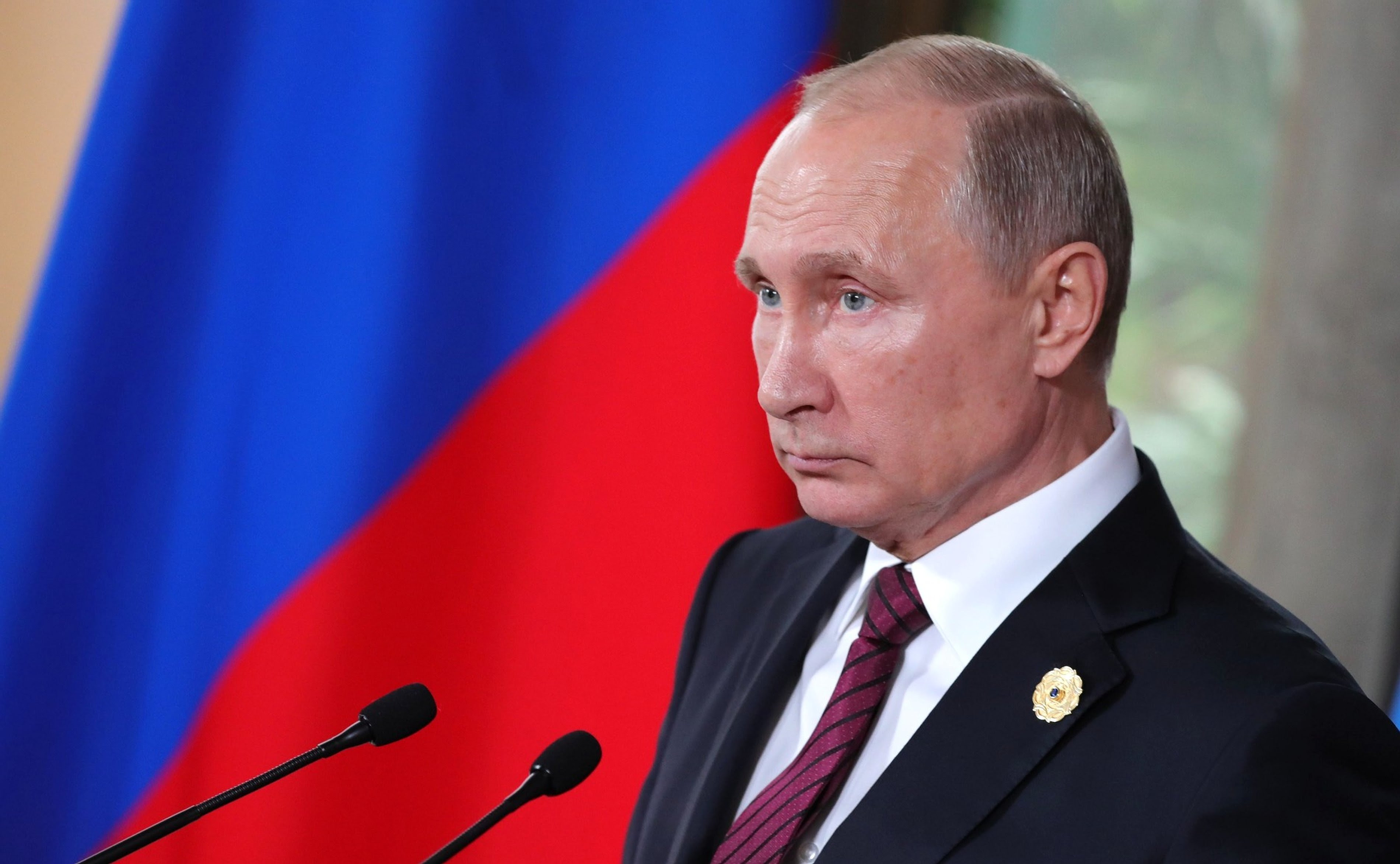 Russian President Vladimir Putin holds a press briefing at the conclusion of the 25th APEC Summit meeting November 11, 2017 in Vietnam.
