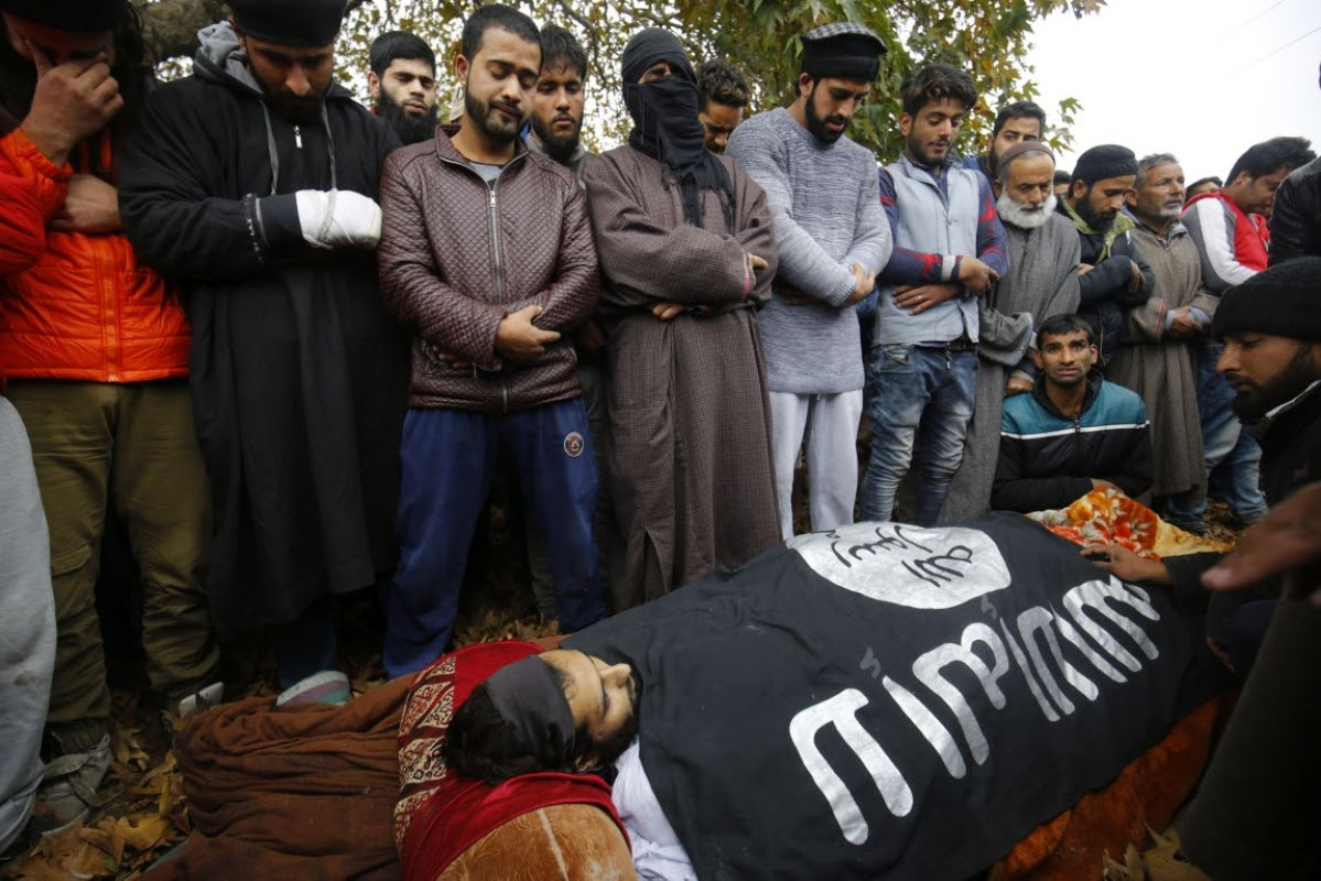 People in Srinagar performing Namaz-e-Janazah of the militant Mugees Ahmad Mir of Parimpora who was killed in an encounter. Sub-Inspector Imran Tak of Jammu and Kashmir Police was also killed in the same encounter in Zakoora on 18 November.