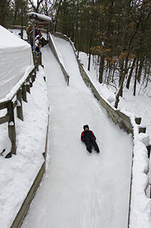 Person on luge track at Muskegon State Park