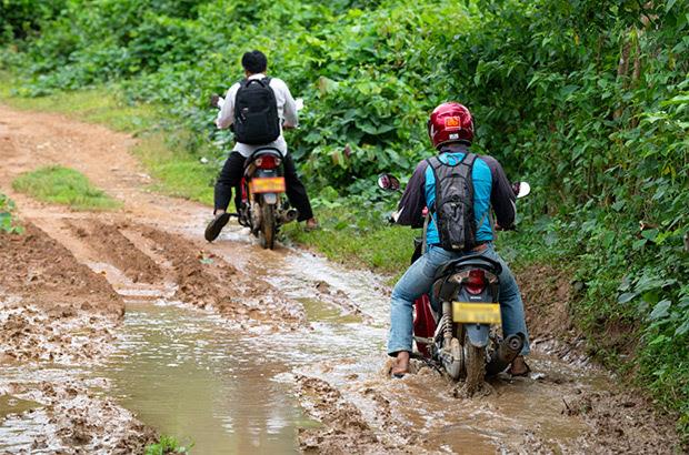 Men driving motorbikes