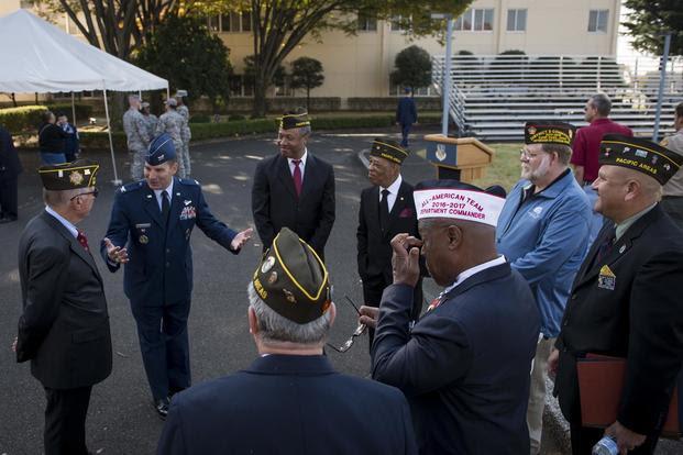 Col. Sergio Vega speaks with members of the Veterans of Foreign Wars Post 9555 during a Veterans Day Ceremony, Nov. 10, 2017, at Yokota Air Base, Japan. (U.S. Air Force/Senior Airman Donald Hudson)