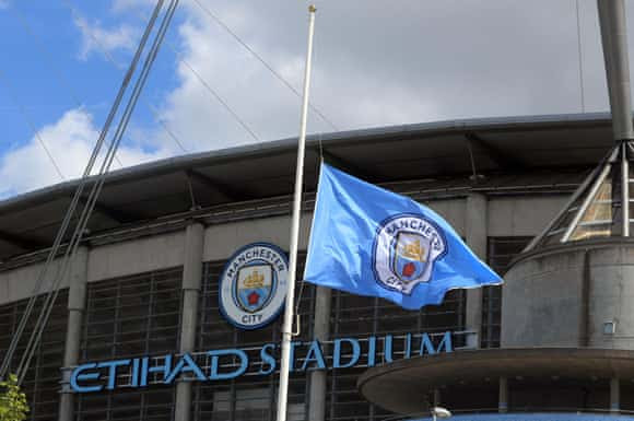 And a City flag flies at half mast outside the Etihad Stadium, which is being used as a support centre following the attack.