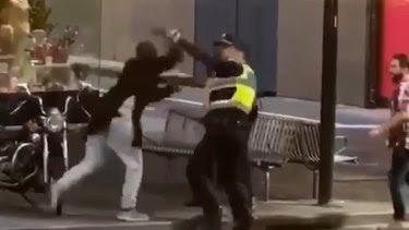 Police confront Hassan Khalif Shire Ali in BourkeStreet last year.