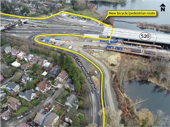 An aerial view of SR 520 in Montlake. There is a yellow line labeled new bicycle pedestrian route under the highway.