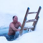 Yeah, it's as cold as it looks--but not so bad after a 260-degree sauna. Tommy Moe does the ice plunge. Photo: Colin Wiseman.