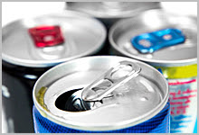 A collection of canned drinks that contain sugar.