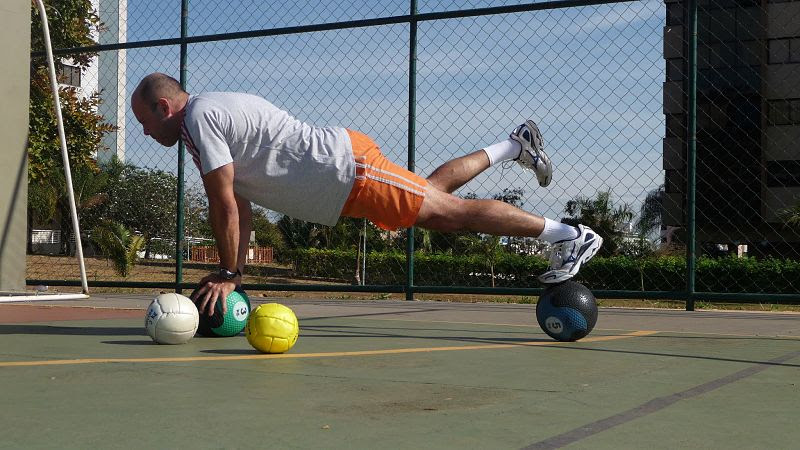 File:Plank on a pair of medicine balls.jpg