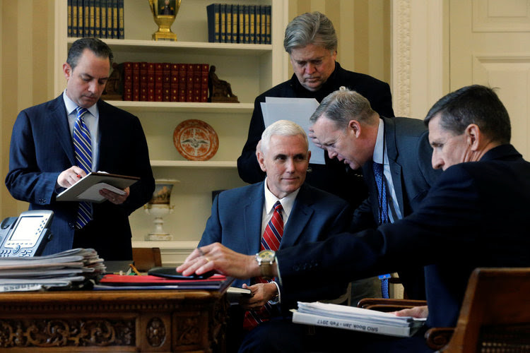 Reince Priebus, Mike Pence, Steve Bannon, Sean Spicer and Michael Flynn listen as President Trump speaks by phone with Vladimir Putin in the Oval Office on Jan. 28. (Jonathan Ernst/Reuters)</p>