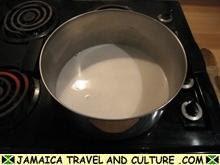 Mackerel Run Down - Heating the coconut milk and water