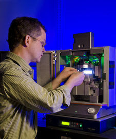 NIST/JILA biophysicist Tom Perkins used this atomic force microscope to measure protein folding in more detail than ever before.