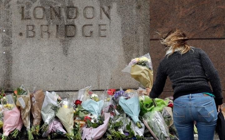 A woman places flowers on London Bridge after the latest terror atrocity to hit Britain