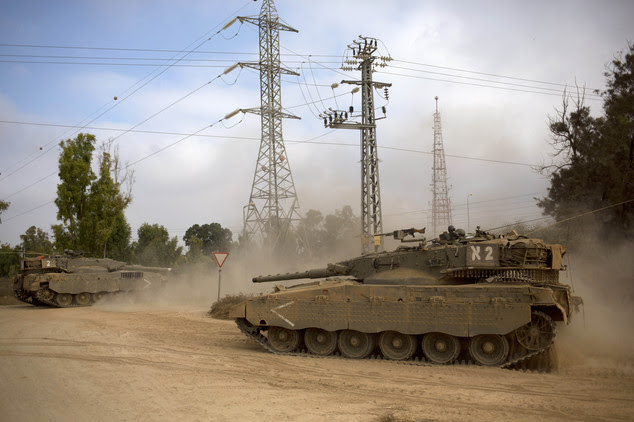 Israeli tanks move near the Israel and Gaza border Thursday, July 24, 2014. Israeli tanks and warplanes bombarded the Gaza Strip on Thursday, as Hamas milita...
