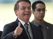 President Jair Bolsonaro leaves the Palacio do Alvorada, Brasilia, Brazil, March, 27, 2020.
