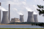 A coal-fired power plant in Juliette, Ga., in 2007. Roughly half of Americans say steps like restricting power plant emissions and improving vehicle fuel efficiency could make a big difference in combating climate change, a Pew Research Center poll found.