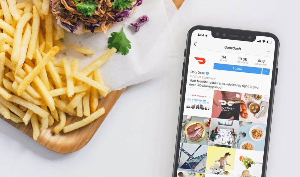 DoorDash app open on a phone next to food