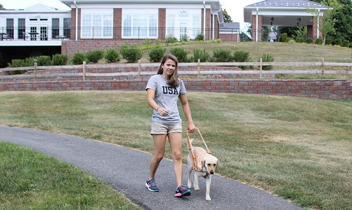 Becca Myers and Birdie on campus