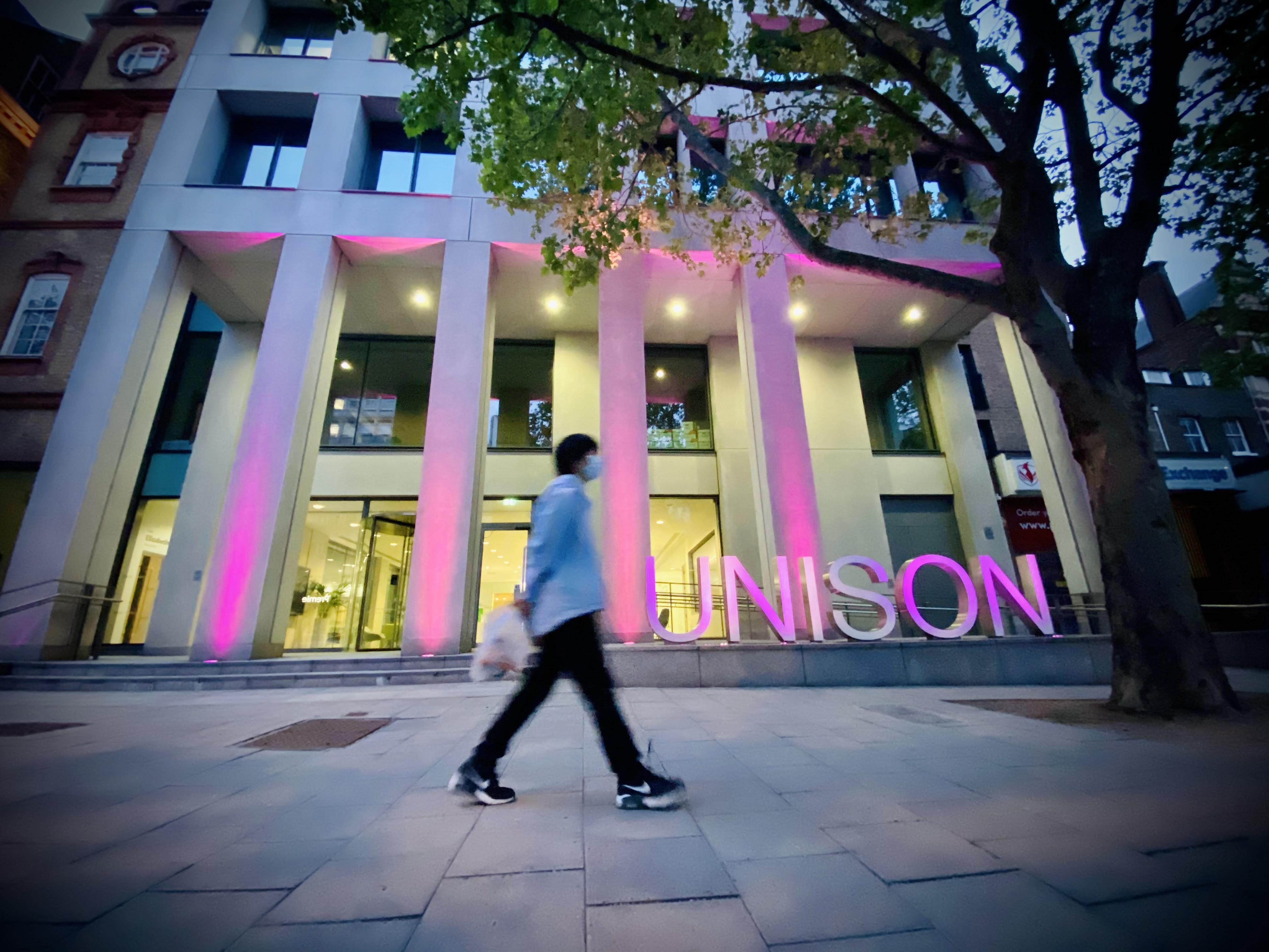UNISON Centre lit in purple