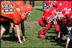 The figure above is a photograph showing two football teams squaring off.